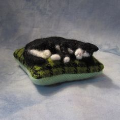 PLACE AN ORDER for a Sleeping Kitty Pincushion (21513). $42.00, via Etsy.