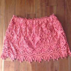 """🌺 🎉HP🎉Coral Crochet Mini Skirt🌺 So pretty. A little too short for me though, must go to a new home.  Color is best shown in pics 3 and 4.  Looks great for spring/summer with a tank and sandals or for fall with tights and boots. These kind of skirts were on so many blogs this year. I wish I could have gotten more wear out of this great piece!!  I did try wearing this piece twice but it's in excellent condition!!  Length 14"""" Width 13"""" Lining 10"""" Oxford Circus Skirts Mini"""
