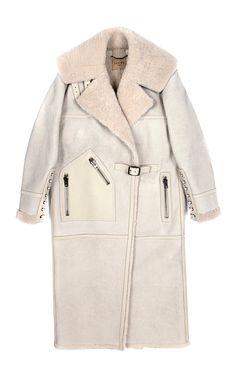 This dark sand leather Loewe coat features tonal shearling lining, a notched collar, exposed zip hip pockets, lace-up detail at the cuffs and a self-buckle half belt at the front.Self-buckle closureSheepskinFully linedMade in MadridPlease note: This item is returnable for credit or full refund.