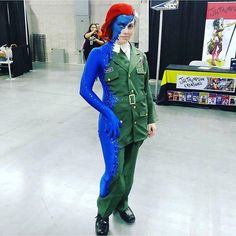 "Mistique - ""Well I picked Mystique cause 1) love her and 2) it was gonna be a cool makeup challenge. Making it was tough and I totally had my mom sew me in to the thing and help glue on the sequins. I used an army costume from Ebay and a cheapo body suit from Amazon. We just cut off the extra and sewed the uniform on top of the blue. The sequins helped cover up all the seems. I also used two wigs and sewed those things together (so tough!!!) and sprayed the mystique hair bright red."""