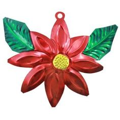 This colorful tin poinsettia ornament was hand punched and hand painted in Oaxaca, Mexico.  A funky and whimsical addition to your Christmas tree, and a neat collectible, too!  Each ornament is painted on both sides, and has a hole in the top where a string can be attached for easy hanging.