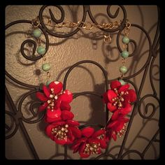 Anthropologie camellia bib necklace Adorable red floral statement necklace with sparkling center and turquoise beaded detail and gold adjustable chain. The perfect statement piece! In brand new condition, never been worn :) Anthropologie Jewelry Necklaces