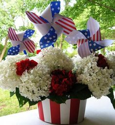 Fourth of July centerpiece. The container is a cardboard Uncle Sam hat filled with hydrangeas and patriotic pinwheels.