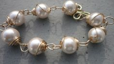 Bracelet Hand Coiled Glass Beads in Pearl by LOVEitAllBoutique on Etsy https://www.etsy.com/listing/233342302/bracelet-hand-coiled-glass-beads-in