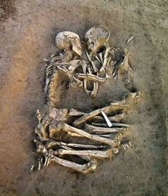 """The so-called Lovers of Valdaro, also dubbed as the """"Valdaro Lovers,"""" are a pair of human skeletons dating back 6,000 years discovered by archaeologists at a Neolithic tomb in S.Giorgio near Mantova, Italy, in 2007. The two skeletons appear to have died or were interred facing each other with arms around each other, thus reminiscent of a """"lovers' embrace"""".Archaeologist Elena Maria Menotti led the excavation. Scientists believe that the pair is a man and woman no older than 20 years old and…"""