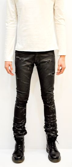 """DIOR HOMME  DESTROYED JEANS::   In year 2004 , Hedi Slimane rocked the runway by creating the most  gorgeous and unique Rock n' Roll jeans ever made in the fashion history """"DESTROYED"""". The jeans are made from 100% premium Italian denim with special black resin coated treatment and extraordinary ripped and destroyed area. Black inside lining on the front part makes it impossible to see any skin. The particular design made this masterpiece became the legend of Dior Homme ever since."""