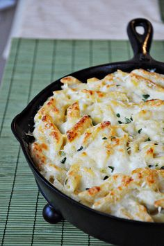 three cheese mac with garlic, goat cheese, white cheddar, parmigiano-reggiano and sour cream.