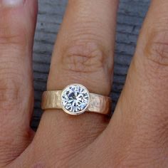 moissanite engagement ring love the thick band and gold Wish this was in silver and it would be PERFECT.