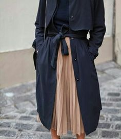 This black trench coat and high waisted pleated skirt are wardrobe essentials