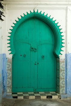 Morocco...  Turquoise and incredible door shapes