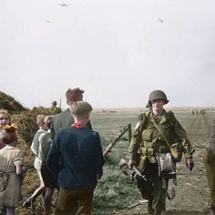the_ww2_memoirs Dutch children curiously look at their liberators, Paratroopers from the 101st Airborne Division, shortly after dropping from their C-47 transports, September 17th, 1944. I'm particularly proud of this coloraztion because of the civilian clothing which is periodically accurate to the year and nation! For the little girls bow (Second from the right) I colored it the patriotic Dutch color orange as a nod to their roots and country. I did this because there was no way to tell…