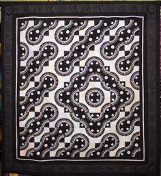 """""""Evening in Times Square"""" by Ingrid Whitcher, 2009 IHQS show. """"The inspiration for this design was the challenge to make a quilt for the Pensacola Quilter's Guild 2008 show that used the New York Beauty block. It has over 1,500 paper-pieced points."""""""