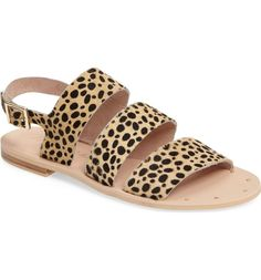 Soft, genuine calf hair brings distinctive texture to this three-strap flat sandal detailed with tiny gleaming studs at the toe.