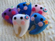 MUST have one of these for Bri! Too cute! Hard to believe all the hard work of getting those baby teeth in now will all be in vain--good thing the tooth fairy will be good to her in this adorable pillow!