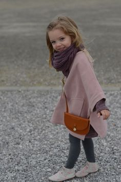 This child is fabulous!! Poncho by Talc - Kaszka Z Mlekiem..Maddie will never keep this on, but it could be worth a shot!
