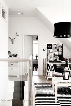 Love those Danish spaces , all interior with sprinkles of black to give distinct touch to the space.