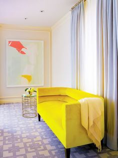 This chartreuse settée is just golden enough to add warmth and sunshine-y color to this bedroom space.