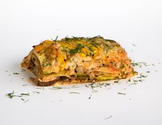 Lasagna: Cashew and cauliflower sauce layered with our soybean lasagna sheets and aubergine, zucchini and shiitake mushrooms, topped with fresh dill