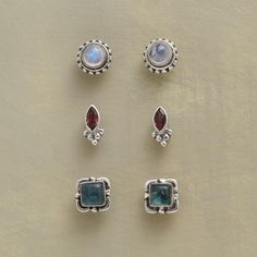 "OLD GLORY EARRING TRIO -- Iridescent white moonstones, blue apatites and red garnets…each pair set in sterling silver. The set of three studs is a handcrafted exclusive. 1/4"" to 5/16""L."