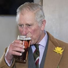 Prince Charles sips on a pint of beer at a visit to a local pub in Cilycwm, Wales