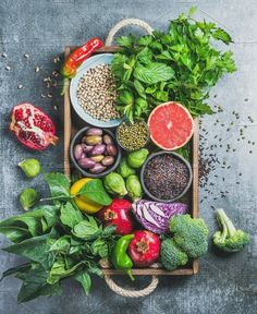 #Healthy food ingredients Vegetables fruit seeds cereals beans spices superfoods herbs condiment in wooden box for vegan gluten free allergy-friendly clean eating or raw diet. Grey concrete background and top view #DetoxRecipesFood