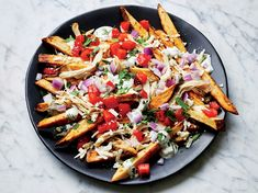 Make Loaded Greek Feta Fries in an Air-Fryer—Just 383 Calories | This dish gets tons of flavor from the spices. If your fresh oregano is strong, start with less than what's called for and add more to taste. To speed things up, prep all the ingredients in advance so you can assemble quickly while the fries are still hot. The fries are easy to make in an air fryer, but if you don't have one (yet) no problem: Spread potatoes on a baking sheet coated with cooking spray; bake 10 minutes at 450F.