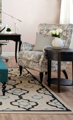 I like patterned chairs and I like this one paired with that simple little side table!