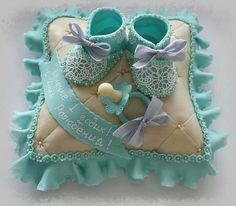 Baby shoes, pacifier & pillow cake