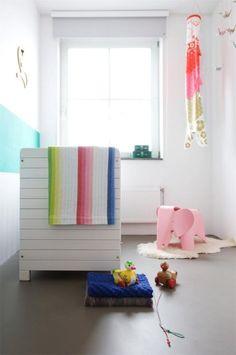 pretty, horizontal aqua stripe on the wall of this little, modern nursery