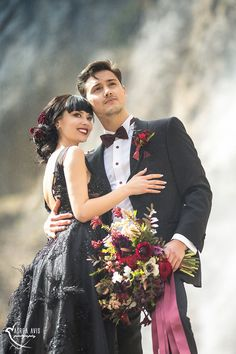 BLACK QUEEN   STYLED SHOOT Black Dress   Braut   Bride   Red   Mountains   Switzerland   Bouquet   Waterfall   Dress   Couple   Engagement
