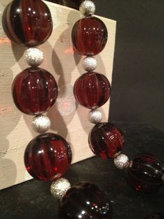 Brilliant clear red round beads are paired with by Bedotted, $32.50