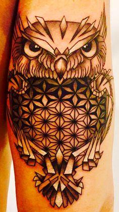 Owl arm tattoo