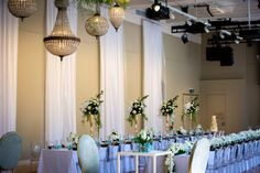 Can't go wrong with the classics.  Showtime Event Group in the Isabella Fraser Room at the State Library Victoria for our Wedding Open Day  Tables, chairs and settings by Dann Event Hire. Chandeliers by Luxe Chandeliers, wall draping by Active Draping and Centrepieces by Bouquet Melbourne