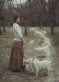 photo girl  little goat