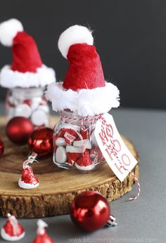 These Santa Hat Jars are so adorable, be sure to fill them with Hershey's Kisses Santa Hat Chocolates you can find at target. Such a fun gift idea or party favor.