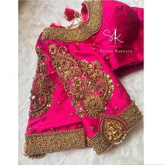 Pick is the colour for all seasons! Gorgeous pink color designer blouse with floral design hand embroidery gold thread and bead work on sleeves and neckline. 09 May 2019 Wedding Saree Blouse Designs, Pattu Saree Blouse Designs, Fancy Blouse Designs, Blouse Neck Designs, Blouse Styles, Pink Blouse Design, Stylish Blouse Design, Floral Design, Blouse Designs Catalogue