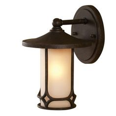 @Overstock - Aged Bronze Transitional 1-light Outdoor Wall Sconce - Brighten your space with this transitional wall sconce. An aged bronze finish and etched seedy glass shade highlight this one-light, outdoor light.     http://www.overstock.com/Home-Garden/Aged-Bronze-Transitional-1-light-Outdoor-Wall-Sconce/7879792/product.html?CID=214117  $43.19