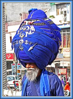 Kesh is the uncut hair of a Sikh male. A turban (Dastaar) is worn to protect the Kesh and guard the Dasam Duaar Gate) - the spiritual opening at the top of the head. We Are The World, People Around The World, Photomontage, Henna Designs, Anti Religion, Portraits, World Cultures, Atheism, Electric Blue