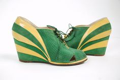 Vintage 1930s two tone wedge shoes are phenomenal in emerald green suede and buttery yellow leather. The photos say so much more than words can capture - these are the rarest, most unique sports shoes Ive had from the 30s or 40s. Looking like a 1939 advertisement, they are brightly colored