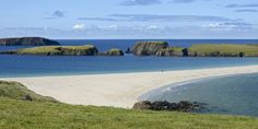 St Ninian's Isle and the tombolo of sand joining it to the Mainland at  Bigton, Shetland. There are two people on the beach:-)