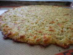 Yummy Cauliflower Pizza Crust - 6 out of 6 liked this in my family for dinner tonight. 1/8 of this pizza, made with pizza sauce and light cheese = 49 calories!