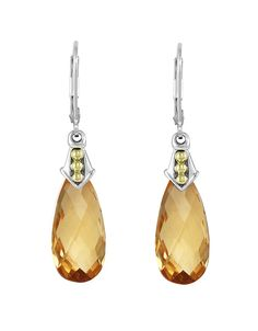 The final touch - pair of Prism Citrine Gemstone Drop Earrings before heading out to the Winter gala.