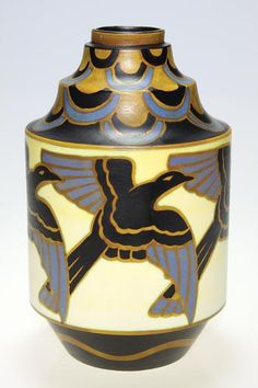 Humler & Nolan | June 2010   Good Boch Freres matteenamel Art Deco vase with a repeating land of magpies in flight done on a stepped body. The design is Charles Catteau and in this instance, thedecoration is done by Leon Delfant. Design number D. 1366