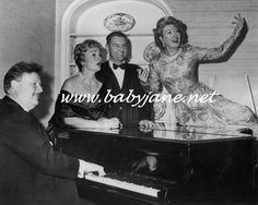 Greer Garson atop a piano, 1950s