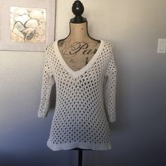 Ann Taylor Crochet Cream Colored Top (long sleeve) Gorgeous crochet top from Ann Taylor! This top is in excellent condition with no tears or stains. I would throw on a spaghetti strap shirt and out this over with some cute blue or white jeans and I was on my way!! This sleeves ran down to my elbow.  Ann Taylor Tops