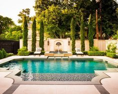 Traditional pool with water feature