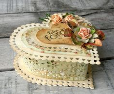 I have all these heart shaped boxes.... now I know what to do with them! Very Vintage looking