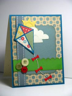 *******SU Island Indigo, Poppy Parade & Confetti Cream cardstock. WeR Memory Keepers Comstock Sky (Summertime) dsp & Cosmo Cricket Togetherness dsp(kite), buttons. MFT kite, cloud die, SU scallop border punch, ribbon