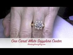 """In this quick video taken by our receptionist Stacy, you see what a one carat round """"White Sapphire"""" looks like in our Lotus Flower engagement ring, Yell. Popular Engagement Rings, Unique Diamond Engagement Rings, Antique Engagement Rings, Designer Engagement Rings, Rose Wedding Rings, Thing 1, Diamond Alternatives, 1 Carat, White Sapphire"""