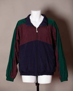 A personal favorite from my Etsy shop https://www.etsy.com/listing/546488495/vintage-90s-mens-windbreaker-dark-colors